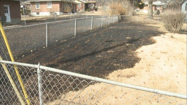 One of the many backyards that were damaged by fire on Sunday. (Credit: KMOV)