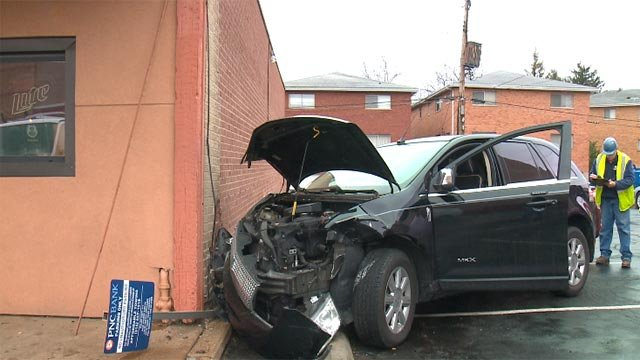 A woman crashed her vehicle into the side of Barney's Sport Pub in South City (Credit: KMOV)