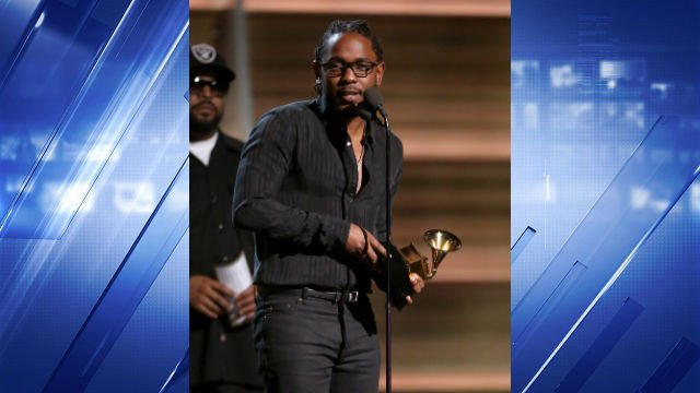 "Kendrick Lamar accepts the award for best rap album for ""To Pimp A Butterfly"" at the 58th annual Grammy Awards on Monday, Feb. 15, 2016, in Los Angeles. (Photo by Matt Sayles/Invision/AP)"