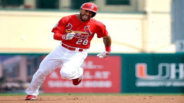 Tommy Pham hustles around second and on to third for a triple before heading home to score on a throwing error during the first inning of an exhibition spring training baseball game Thursday. (AP Photo/Jeff Roberson)