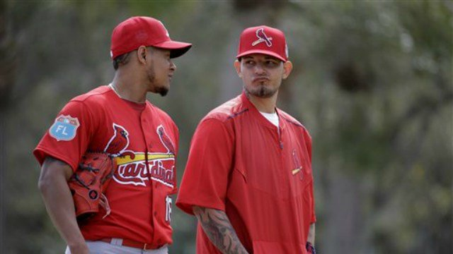St. Louis Cardinals catcher Yadier Molina, right, talks with pitcher Carlos Martinez during spring training baseball practice Sunday, Feb. 21, 2016, in Jupiter, Fla. (AP Photo/Jeff Roberson)