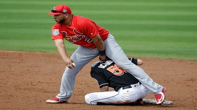 Miami Marlins' Ichiro Suzuki is out at second as Jhonny Peralta fails to turn the double play during the third inning of an exhibition spring training baseball game Saturday. (AP Photo/Jeff Roberson)