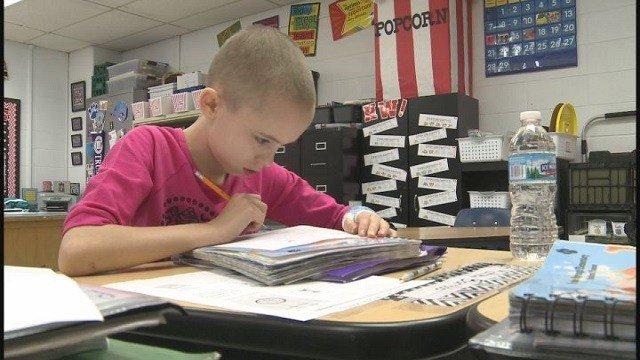 Elementary student who got her head shaved to raise money for the St. Baldrick's Foundation (Credit: KMOV).