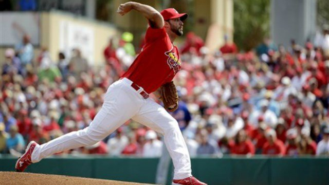 St. Louis Cardinals starting pitcher Adam Wainwright throws during the first inning of an exhibition spring training baseball game New York Mets Monday, March 7, 2016, in Jupiter, Fla. (AP Photo/Jeff Roberson)