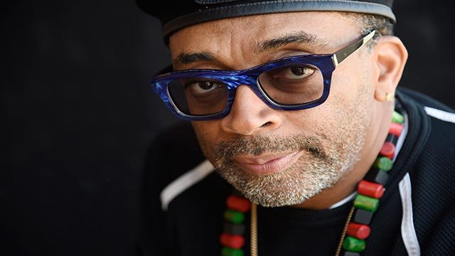 In this Wednesday, Oct. 7, 2015 photo, filmmaker Spike Lee poses for a portrait in Beverly Hills, Calif. Reflecting on his career as he prepares to accept an honorary Oscar (Credit: Chris Pizzello / Invision / AP)