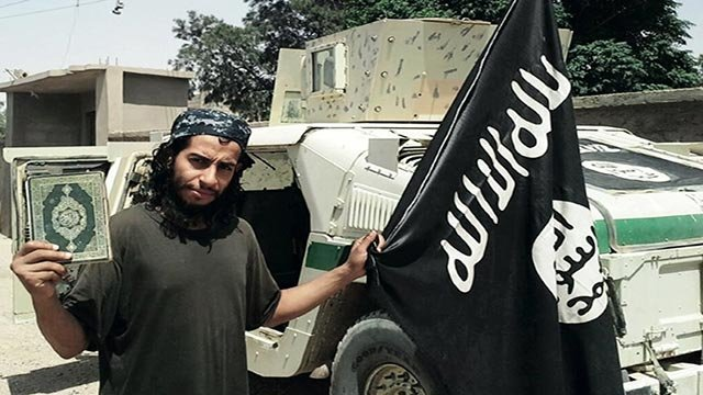 Undated picture taken on November 16, 2015 from the February 2015 issue 7 of the Islamic State (ISIS) group online English-language magazine Dabiq, purportedly shows 27-year-old Belgian IS group leading militant Abdelhamid Abaaoud