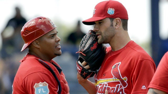 St. Louis Cardinals starting pitcher Jaime Garcia, right, talks with catcher Brayan Pena before being pulled out of an exhibition spring training baseball game against the New York Mets during the fourth inning Thursday, March 10, 2016, in Port St. Lucie,