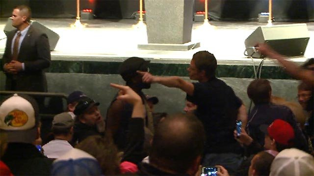 A protester was kicked out of the Trump rally in downtown St. Louis Friday. (Credit: KMOV)