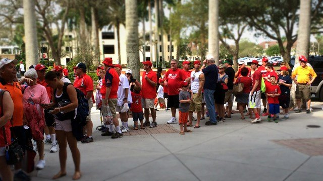 A line of fans waits outside Roger Dean Stadium before the Cardinals and Tigers play. Photo Credit: KMOV