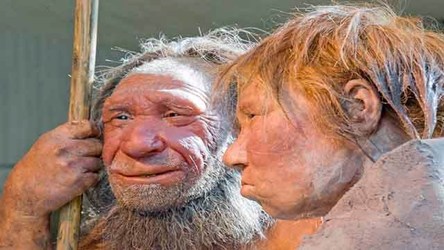"""The prehistoric Neanderthal man """"N"""", left, is visited for the first time by another reconstruction of a homo neanderthalensis called """"Wilma"""", right. (AP Photo/Martin Meissner)"""