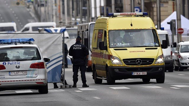 An ambulance leaves the metro station, closed by police, in Brussels, Belgium. Authorities locked down the Belgian capital on Tuesday after explosions rocked the Brussels airport and subway system, killing a number of people and injuring many more. (AP)