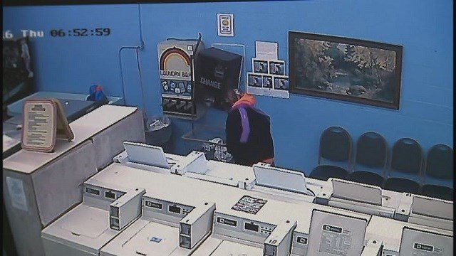 Surveillance footage from the Pevely Laundromat allegedly shows the suspect robbing the change machine. (Credit: Pevely Police Department)