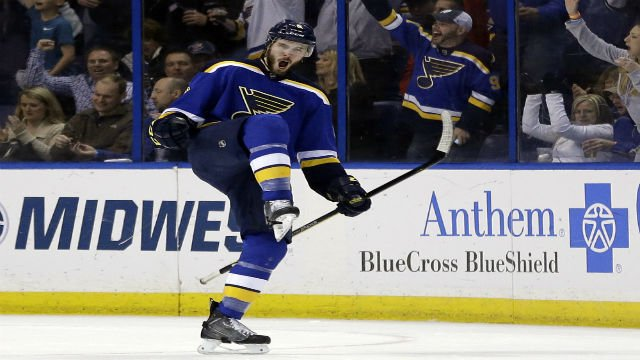 St. Louis Blues' Joel Edmundson celebrates after scoring during the third period of an NHL hockey game against the Vancouver Canucks Friday, March 25, 2016, in St. Louis. The Blues won 4-0. (AP Photo/Jeff Roberson)