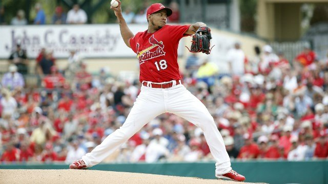 St. Louis Cardinals' starting pitcher Carlos Martinez delivers a ball during the first inning of an exhibition spring training baseball game against the New York Mets, Monday, March 28, 2016, in Jupiter, Fla. (AP Photo/Brynn Anderson)
