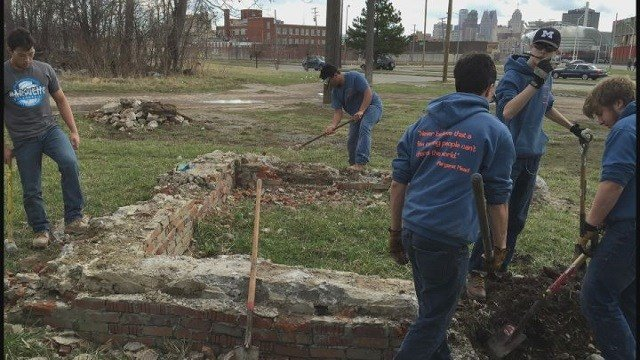 Students from Marquette High School helping flood victims in Detroit (Credit: Parent Drew Selman)