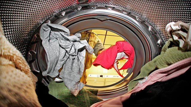 A load of laundry is loaded into a Whirlpool washing machine in an apartment building laundry in Pittsburgh, Thursday, July 19, 2012. (AP Photo/Gene J. Puskar)