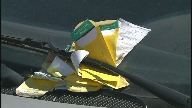 Residents say parked car with tickets piled up caused eyesore in Midtown (Credit: KMOV)