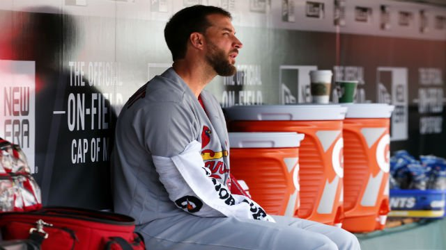 St. Louis Cardinals starting pitcher Adam Wainwright (50) sits in the dugout before the start of an opening day baseball game against the Pittsburgh Pirates at PNC Park in Pittsburgh, Sunday, April 3, 2016.  (AP Photo/Gene J. Puskar)