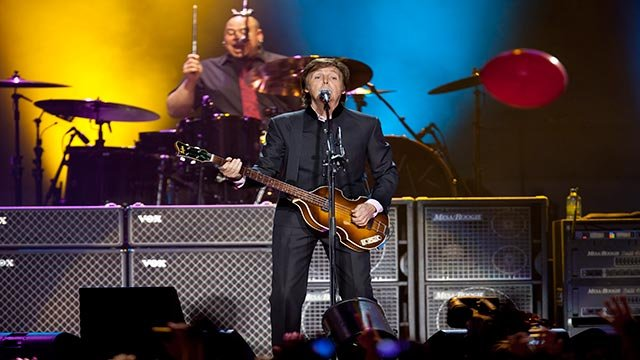 """Sir Paul McCartney performs on stage during his """"Good Evening Europe"""" European Tour, his first since 2003, at Olympic Hall in Moscow, Russia, Wednesday, Dec. 14, 2011. McCartney is giving a concert in Moscow today as part of his tour of Europe. (AP Photo/"""
