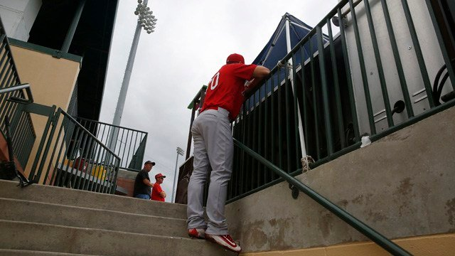 St. Louis Cardinals' Charlie Tilson hangs out on the stairs talking to fans during the seventh inning of an exhibition spring training baseball game against the Miami Marlins, Wednesday, March 30, 2016, in Jupiter, Fla. (AP Photo/Brynn Anderson)