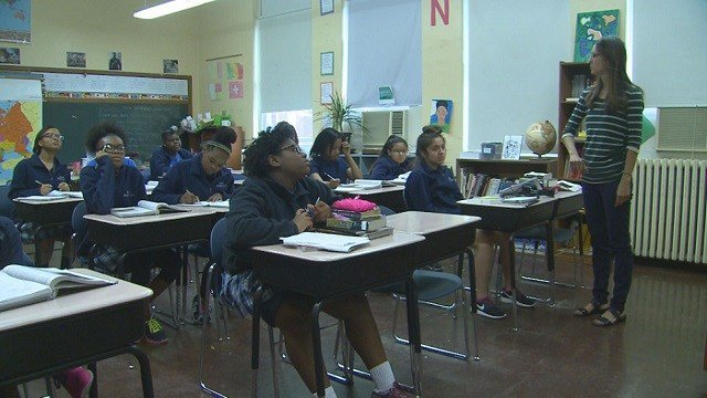 Students listen to their teacher at Marian Middle School. (Credit: KMOV)