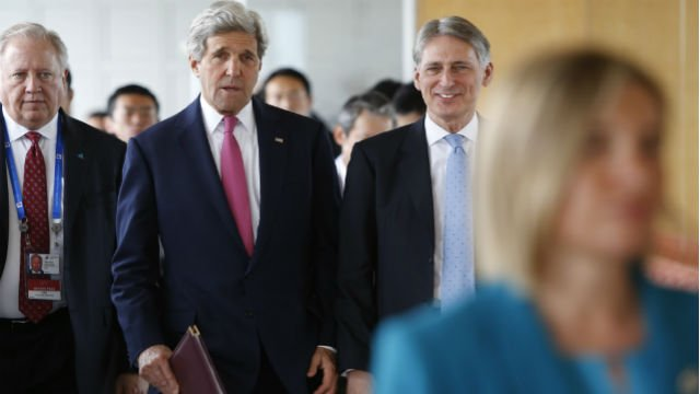 U.S. Secretary of State John Kerry, center, talks with Britain's Foreign Secretary Philip Hammond, right, as they arrive to participate in the first working session of the G7 foreign minister meetings in Hiroshima, Japan April 10. (Jonathan Ernst/Pool