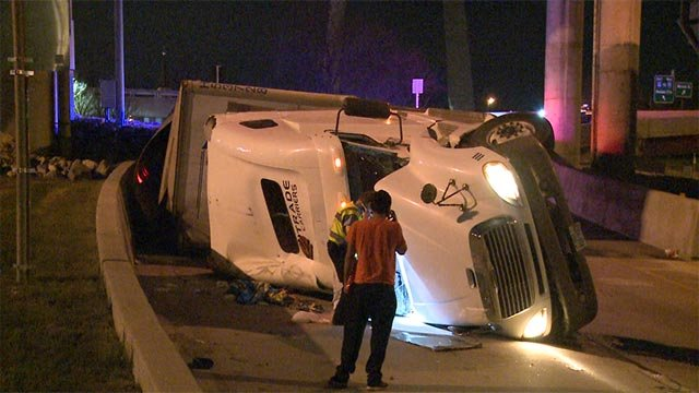 A semi-truck overturned on a ramp near downtown St. Louis early Friday morning (Credit: KMOV)