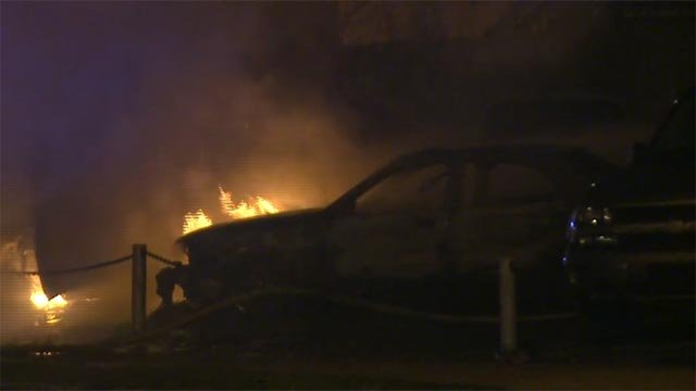 A car was damaged on a north St. Louis lot Friday (Credit: KMOV)