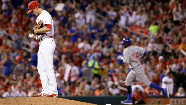 Chicago Cubs' Dexter Fowler, right, rounds the bases after hitting a solo home run off St. Louis Cardinals' Mike Leake, left, during the sixth inning of a baseball game Monday, April 18, 2016, in St. Louis. (AP Photo/Jeff Roberson)