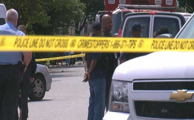Police responded to the scene of a fatal officer-involved shooting August 19, 2015 (Credit: KMOV)