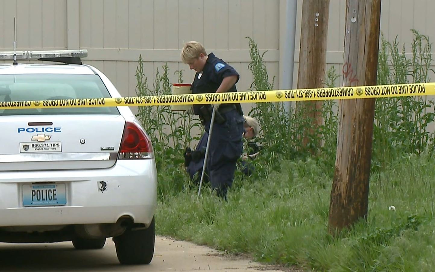 Investigators probe scene of fatal officer-involved shooting in North St. Louis Tuesday (KMOV-TV)