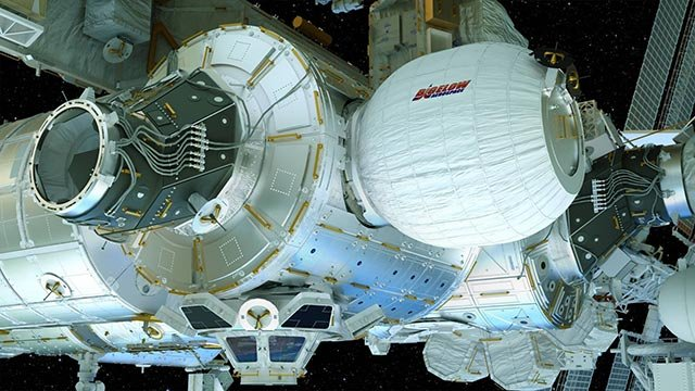 This image provided by Bigelow Aerospace on April 6, 2016 shows an illustration of the Bigelow Expandable Activity Module (BEAM), center right, attached to the International Space Station.  (Credit: Bigelow Aerospace via AP)