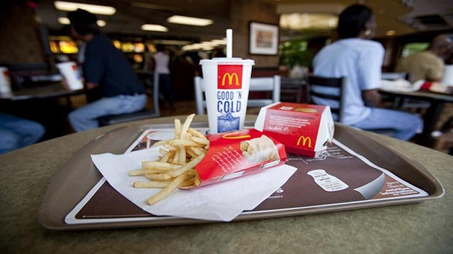 A photograph showing a McDonald's sandwich, french fries, and a medium soda on a serving tray. (Credit: Mark Hill / CNN)