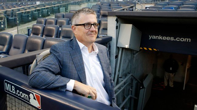 Houston Astros General Manager Jeff Luhnow smiles as he waits in the dugout during a workout at Yankee Stadium in New York, Monday, Oct. 5, 2015, for an American League Wild Card baseball game against the New York Yankees. (AP Photo/Kathy Willens)