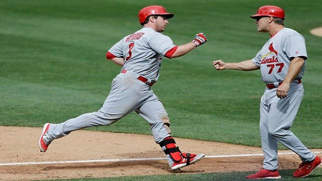 Jedd Gyorko is greeted by third base coach Chris Maloney (77) after hitting a home run during the sixth inning of a baseball game against the San Diego Padres. (AP Photo/Gregory Bull)