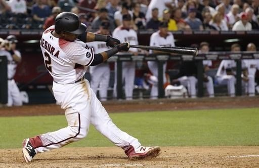 Arizona Diamondbacks' Jean Segura connects on a three-run home run against the St. Louis Cardinals during the sixth inning of a baseball game Monday, April 25, 2016, in Phoenix. (AP Photo/Ross D. Franklin)