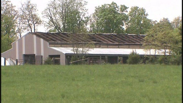 Part of roof ripped off on a barn in New Melle, Mo. (Credit: KMOV)