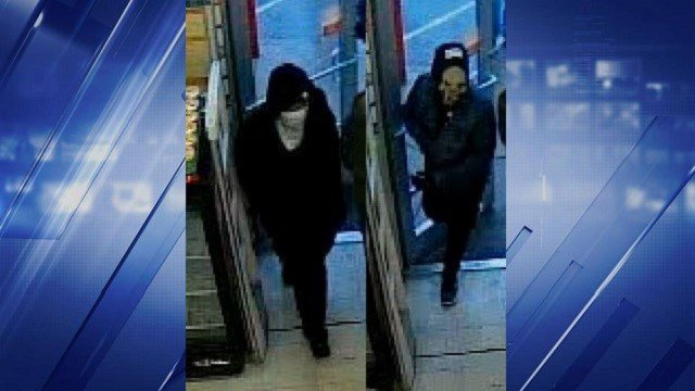 The two suspects covered their faces in each robbery. (Credit: St. Louis Metropolitan Police Department)