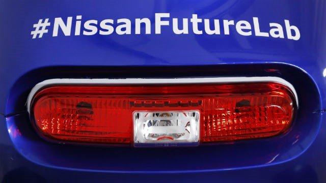 #NissanFutureLab is printed above the brake light of a Nissan Micro Mobility Concept vehicle at the New York International Auto Show. (AP Photo/Mark Lennihan)