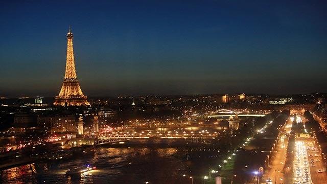 The Eiffel Tower is seen illuminated during nightfall, in Paris, Tuesday, Jan. 12, 2016. (AP Photo/Thibault Camus)