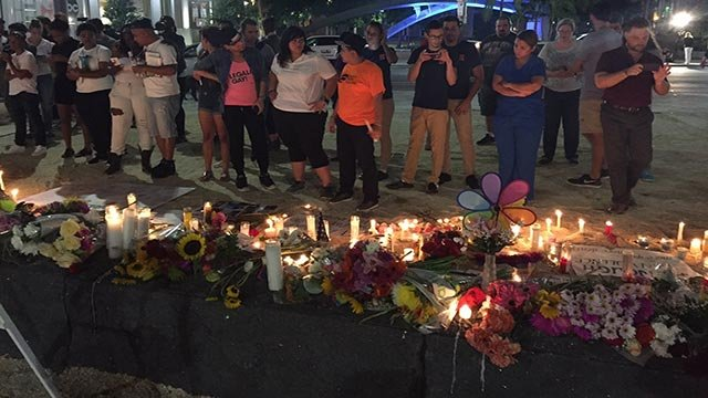 This is a photo at the big vigil at the Dr. Phillips Center in Orlando honorinh the victims of the Pulse nightclub shooting in Florida on June 12, 2016. (Credit: Victoria Kennedy / CNN)
