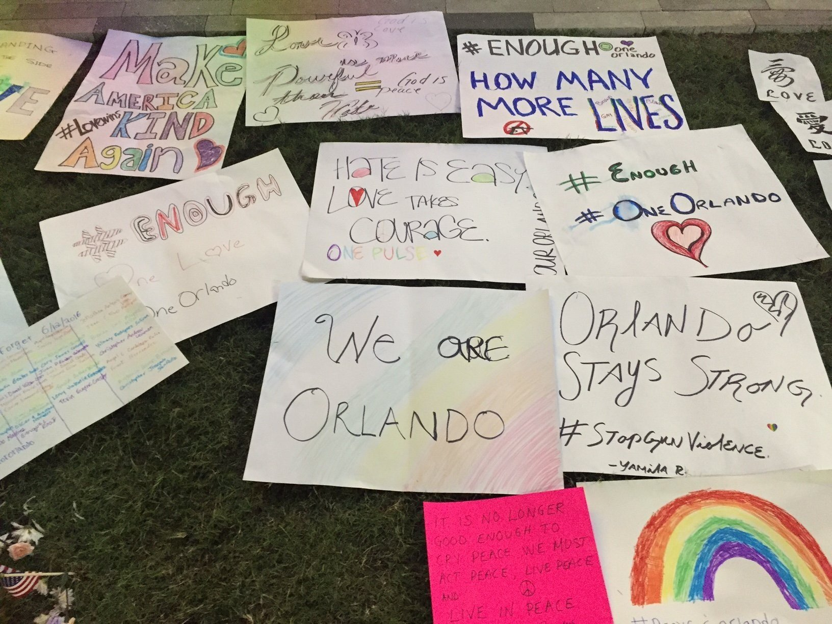 This is a photo at the big vigil at the Dr. Phillips Center in Orlando honorinh the victims of the Pulse nightclub shooting in Florida on June 12, 2016. (Credit: CNN)