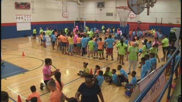 Children from Boys and Girls Club of Greater St. Louis participate in Triple Play Day. (Credit: KMOV)