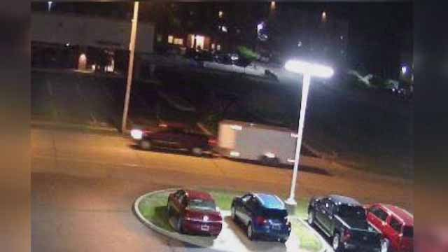 Police believe the suspects who stole the trailer were driving this red or maroon truck. Credit: O'Fallon, Illinois PD