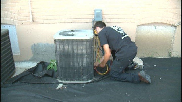 Unique Heating and Cooling fixing an air conditioner. (Credit: KMOV)