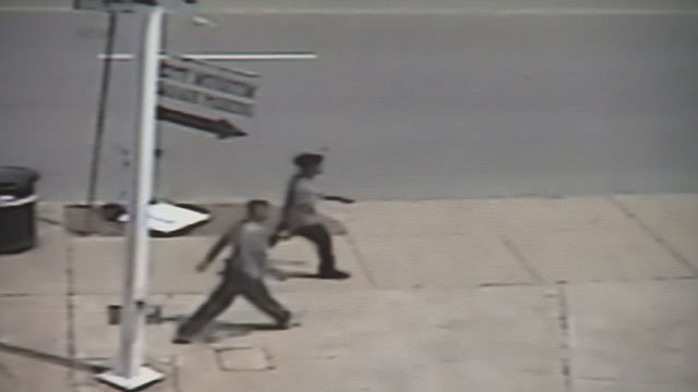 Police searching for two young male suspects that beat, robbed two men in a downtown parking garage on June 23 (Credit: St. Louis Auto Park)