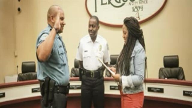 Ferguson Officer Drew Canaday getting sworn in (Credit: KMOV)