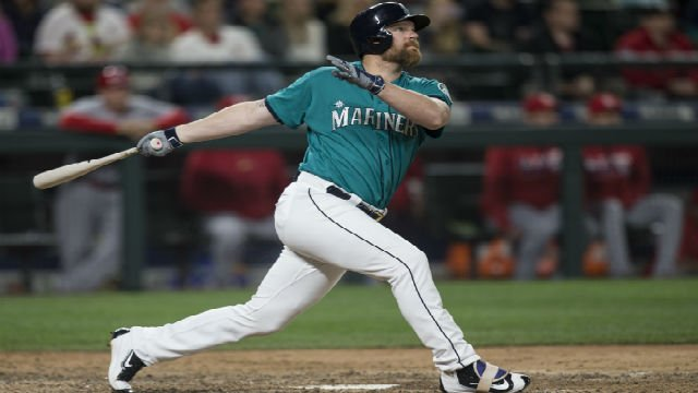 Seattle Mariners' Adam Lind hits a three-run walk-off home run off of St. Louis Cardinals relief pitcher Trevor Rosenthal during the ninth inning, Friday, June 24, 2016, in Seattle. The Mariners won the game 4-3 (AP Photo/Stephen Brashear)