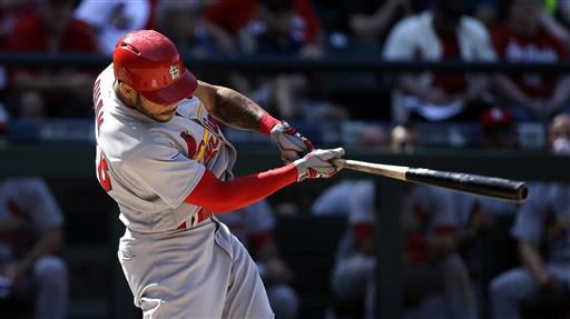 St. Louis Cardinals' Thomas Pham connects for a home run against the Seattle Mariners in the ninth inning of a baseball game Sunday, June 26, 2016, in Seattle. (AP Photo/Elaine Thompson)