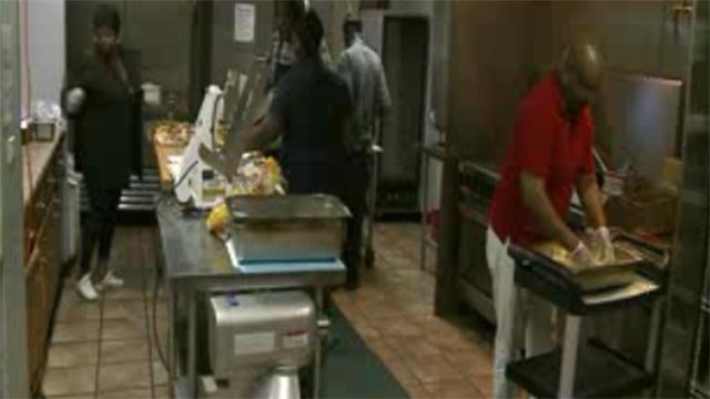 Volunteers preparing Meals on Wheels (Credit: KMOV)